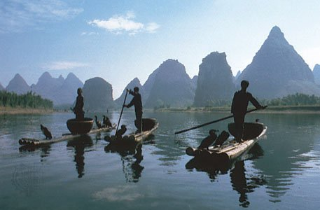 Fishermen and their trained cormorants on the Li River, northeastern Zhuang Autonomous Region of  [Credits : Peter Carmichael-Aspect Picture Library, London]